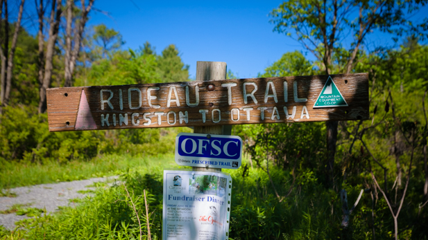 The Rideau Trail weaves across sections of the Cataraqui Trail. You'll know you're on the Rideau Trail when you see orange triangular trail markers.